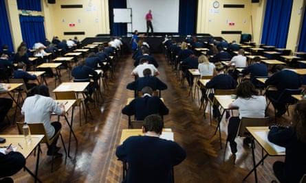 Welsh teenagers sit an exam.
