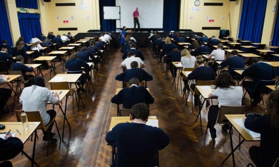 Welsh teenage GCSE school pupils sitting exams in a school hall, Wales UK
