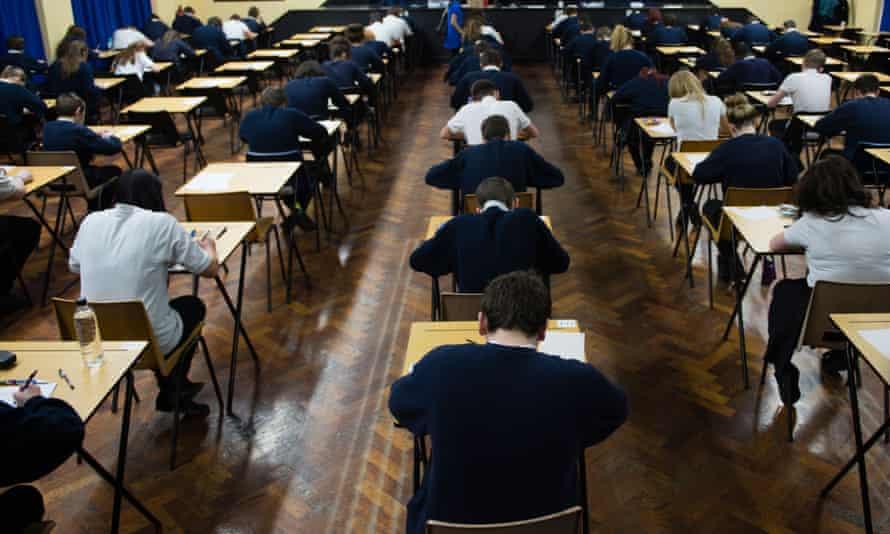 Children sitting GCSE exams.