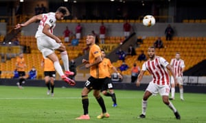 Ahmed Hassan of Olympiacos heads at goal.