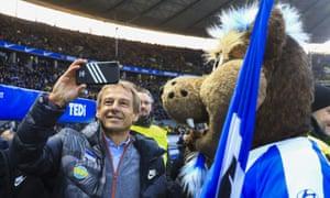 Jürgen Klinsmann takes in the atmosphere on his managerial debut for Hertha back in November.