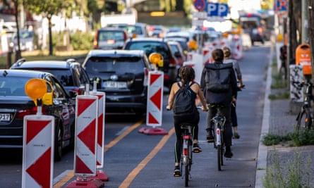 Cyclists use a 'pop-up' bike road in Kreuzberg district in Berlin, Germany.
