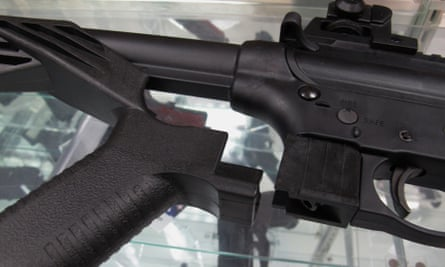A 'bump' stock lies next to a disassembled .22-caliber rifle at North Raleigh Guns in Raleigh, North Carolina.