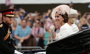 Prince Harry, the Duchess of Cornwall and the Duchess of Cambridge in a carriage as the royal procession makes its way down the Mall from Buckingham Palace