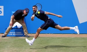 Marin Cilic plays a running shot during his quarter-final victory over Donald Young.