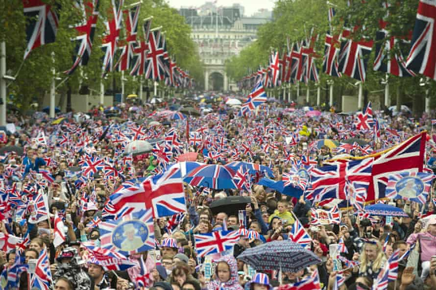 Huge crowds cheering in the Mall to celebrate the Queen's diamond jubilee in London on 5 June 2012.