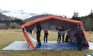 Firemen set up the tent where a mourning ceremony will take place in Le Vernet