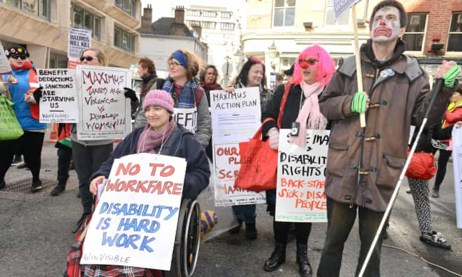 Disabled People Against Cuts hold a day of action against Maximus in London 2015. Maximus are due to carry out assessments on sick and disabled people on their capabilities to work. Protestors are concerned that many claimants will be wrongly found fit for work and lose their benefits.