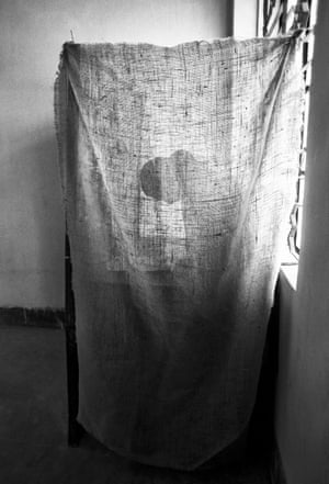 Voting booth, Dhaka, Bangladesh, 1991: a woman in Lalmatia casts her vote behind a makeshift screen after the removal of Ershad, during the first free and fair election in Bangladesh