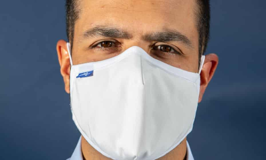 A close-up of Dr Dominic Pimenta's face a wearing an NHS mask