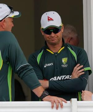 A concerned Michael Clarke talks to his coach Darren Lehmann on the team balcony