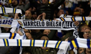 Leeds United fans show their support for manager Marcelo Bielsa during Saturday's game against Norwich.