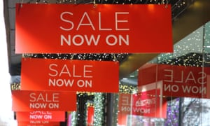Sales signs up at John Lewis in Oxford Street, London, before Christmas