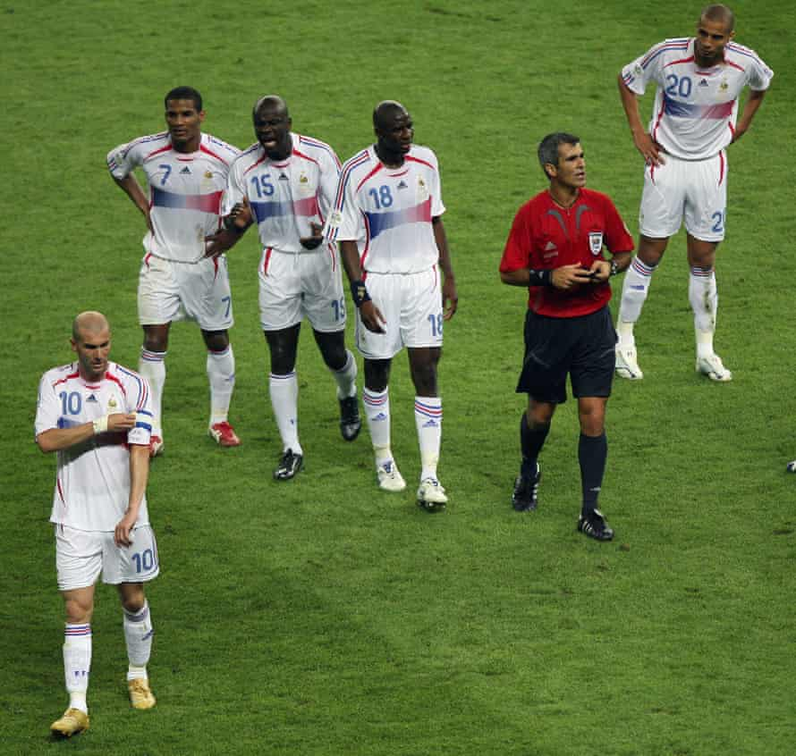 Zidane removes the captain's armband after receiving the red card from the referee, Horacio Elizondo.