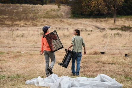 Owl's Nest Farm's Sara Policastro and volunteer Kelsey Figone head to the fields.
