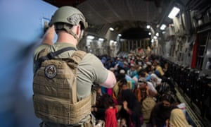 US air force maintains security aboard an aircraft amid the evacuation.
