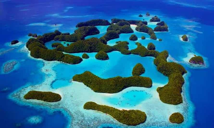Palau's Rock Islands in the tiny Pacific nation of Palau. Climate change could render low-lying coastal areas unliveable, driving forced migration of populations.