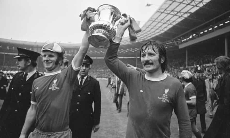 Tommy Smith, right, with Alec Lindsay parade the winning trophy after the 1974 FA Cup final between Liverpool and Newcastle United.