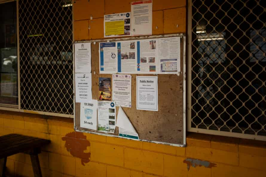 A Queensland Health covid vaccine poster with information on vaccination dates, locations and times is seen on a notice board outside one of two general stroes on Badu Island.
