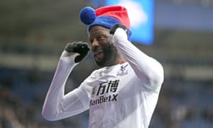 Bakary Sako dons a piece of Palace themed festive head gear as he celebrates an away win that Palace have waited a long time for.