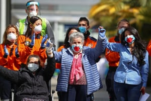 Madrid, Spain: Final patients Maria, Patrocina and Miriam react after being discharged from a temporary hospital set up at IFEMA fairgrounds, before its closure, amid the coronavirus disease