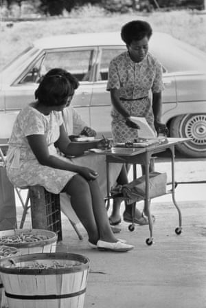 LC Dorsey, a civil rights worker from Shelby, North Bolivar, at the County Farm Vegetable Co-operative, Mississippi, 1968 by Doris Derby.