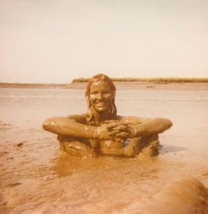 Camilla Buxton wallowing in a mudflat at Blakeney, Norfolk, 1973