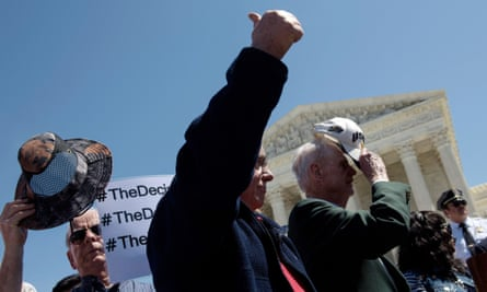 Opponents of immigration reform cheer after singing the US national anthem during a protest outside the supreme court.
