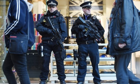 Armed police at St Pancras station in London after the Brussels airport blasts in March 2016.