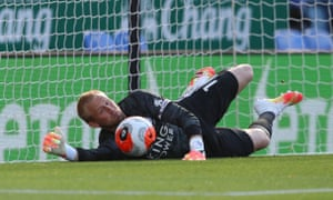 Kasper Schmeichel saves Neal Maupay's penalty.