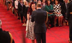 Devon being made an MBE by Prince William last year.