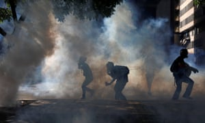 Opposition supporters clash with riot security forces in Caracas on Saturday.