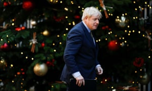 Boris Johnson walks outside Downing Street after winning the general election