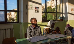 Families from Mali and Nigeria at school in Sutera, learning the Italian language.