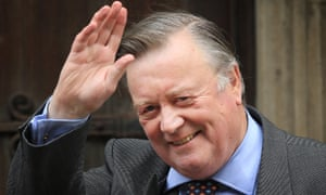 Justice Secretary Ken Clarke waves to photographers as he arrives at The Royal Courts of Justice give evidence to The Leveson Inquiry on May 30, 2012 in London, England.