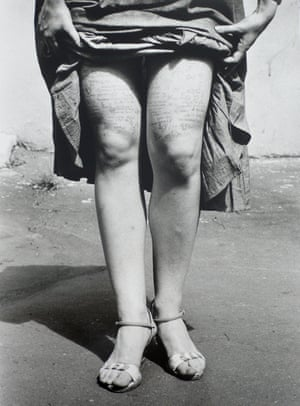 A young woman with crib notes on her thighs, photographed by Valerie Khristoforov in Moscow in 1984.