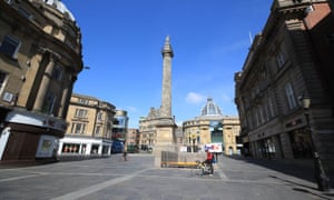 Grey's monument stands at the top of a near deserted street in Newcastle.