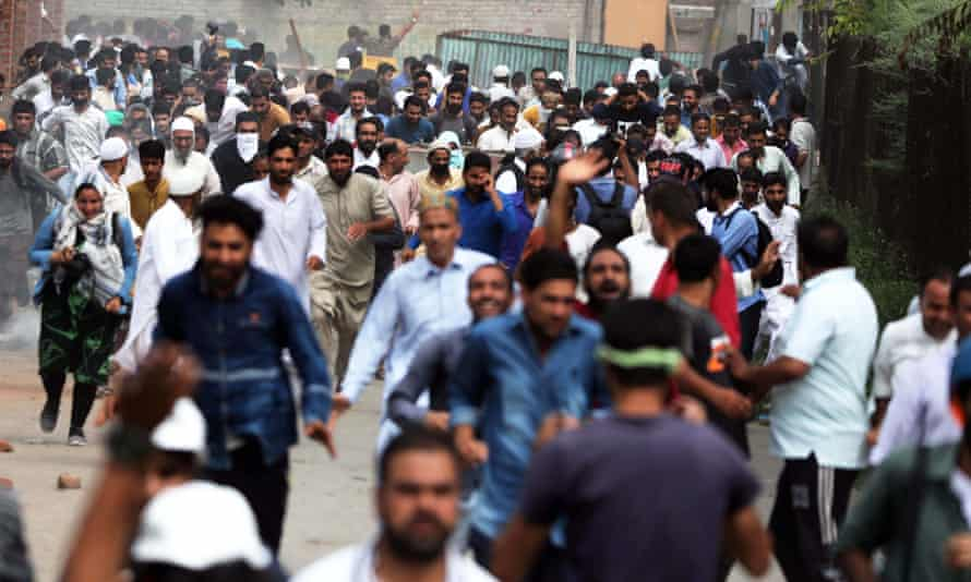 People run during clashes in Anchar last month.