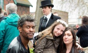 DJ Derek's great niece Jenny Griffiths and her daughter Hannah with Daddy G of Massive Attack at the funeral.