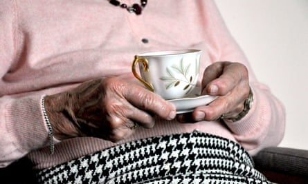 Older woman holding cup
