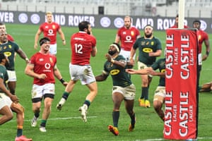 British and Irish Lions' centre Robbie Henshaw catches a ball near the Springbok try line.