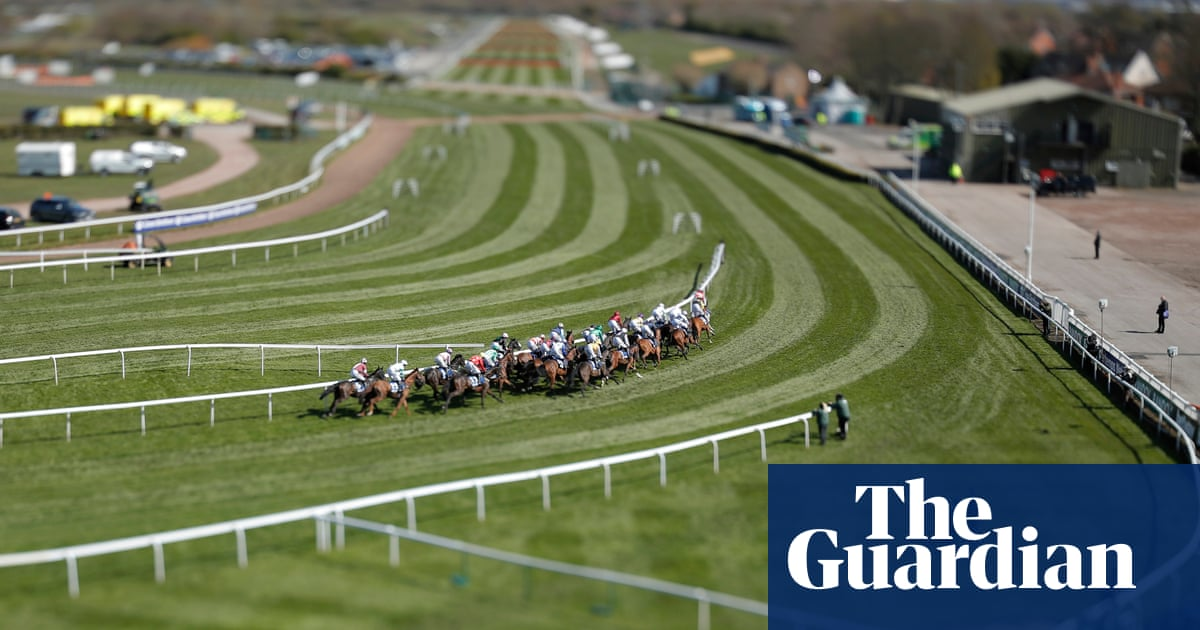 Grand National meeting 2021: empty stands, black armbands and a historic victory – in pictures
