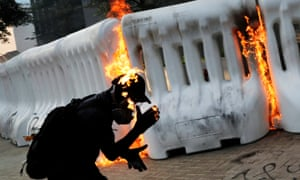 A protester catches fire after a molotov cocktail was thrown during a demonstration near the government complex in Hong Kong.