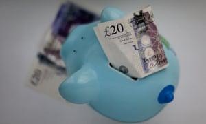 Money sticking out of a piggy bank