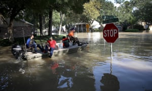 Residents in a neighborhood near the Barker Reservoir return to their homes to collect belongings August 31, 2017 in Houston, Texas. The neighborhoods surrounding the reservoir are still experiencing severe flooding due to the accumulation of historic levels of rainfall.