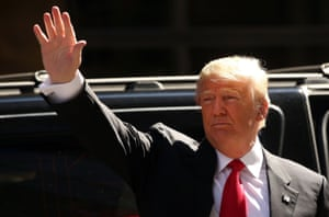Donald Trump greets voters ahead of voting for himself.