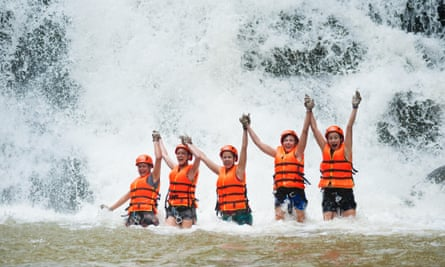 Visitors canyoning in Vietnam near Dalat.
