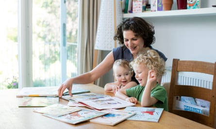 Amelia Hill reading with her children
