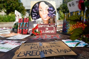 Signs used during protests and rallies are gathered around a memorial for Breonna Taylor in Louisville, Kentucky.