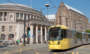 Tram in St Peter's Square, Manchester, with Central Library and the Town Hall extension in the background